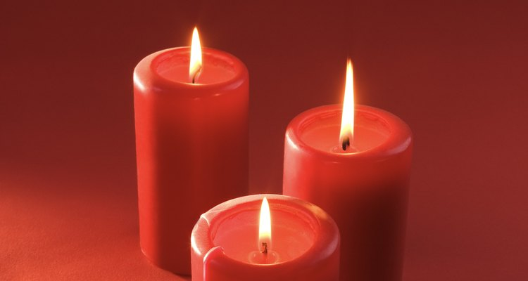 Lighting a few candles around the house is one easy way to decorate for a memorial service.