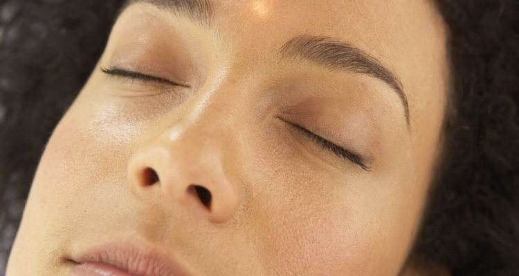 Woman receiving alternative therapy on face