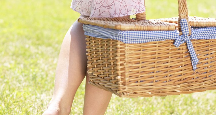 There are plenty of outdoor games that kids can play after they help put together a picnic basket.