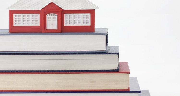 Stack of books and model schoolhouse