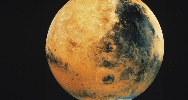 The planet Mars is easy to recreate using papier mache materials.