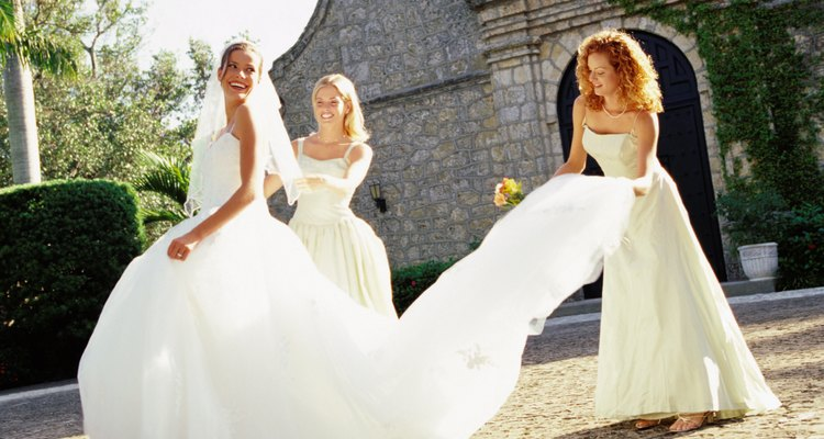portrait of a bride a two bridesmaid outside a church