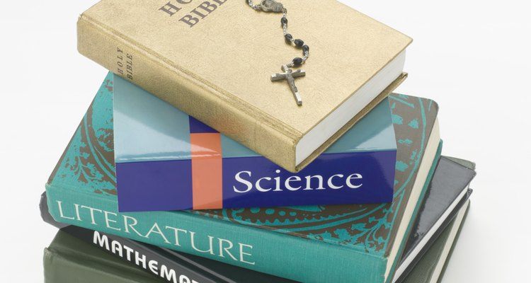 Stack of books and bible