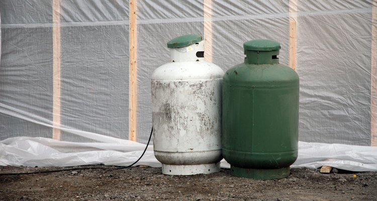 You can paint polythene tanks with acrylic house paint.
