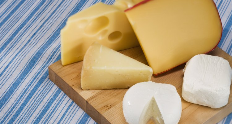 Variety of cheeses on cutting board