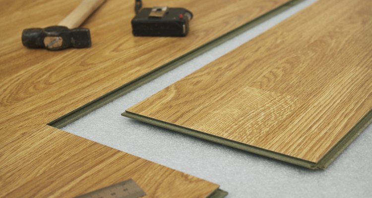 Seal the joins between laminate planks with glue.