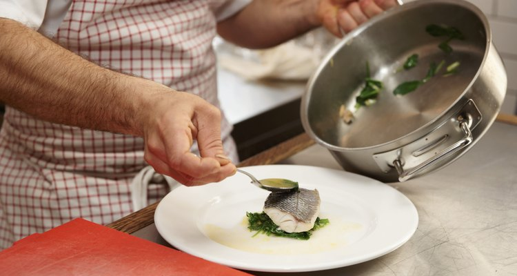 Chef is serving steamed seabass