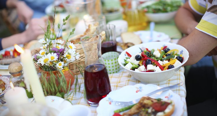 Greek salad, olives and feta cheese, picnic table with food
