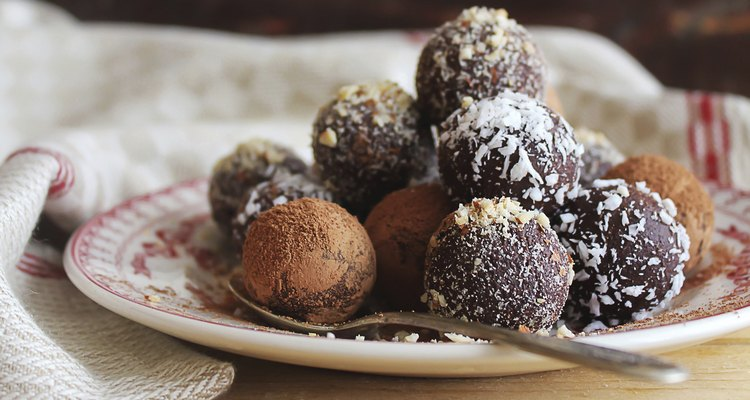 Homemade chocolate truffles with nuts, coconut and cocoa powder