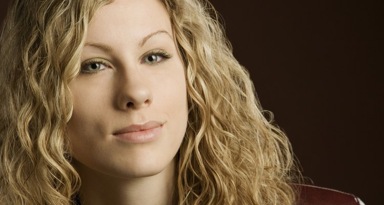 Woman with long blond curly hair