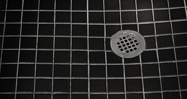 Several potential problems will cause a sewage smell to come from a shower's drain.