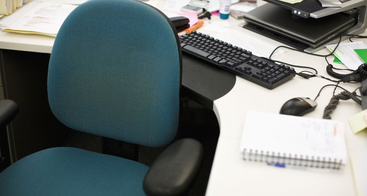 Enhance your boss's chair with a cushion or electronic massager.