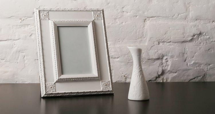 composition with vintage fotoframe and vase