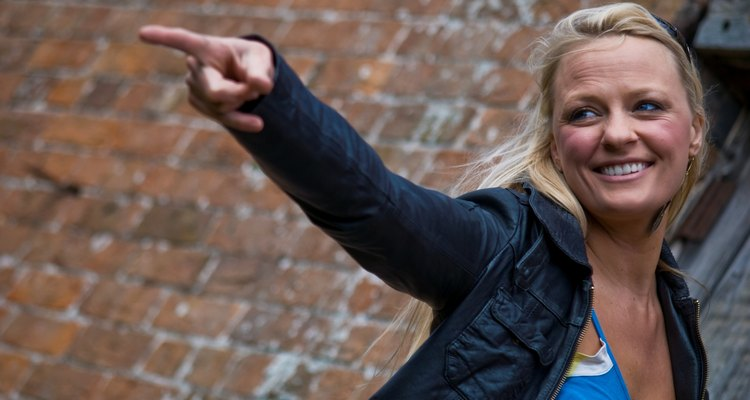 Blonde in leather jacket, pointing