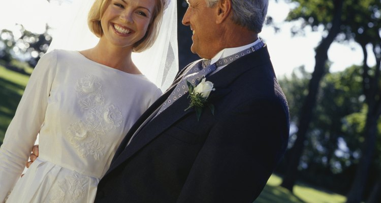 Bride and father in park, close-up