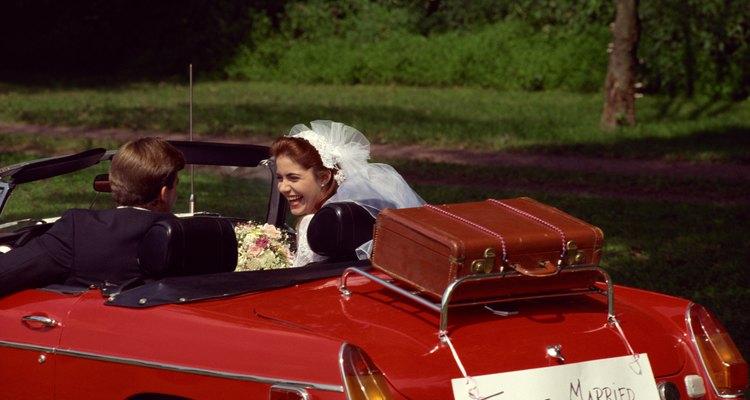 Newlyweds driving in convertible with