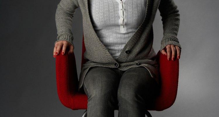 Sit upright in a posture brace.