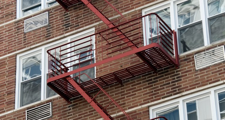 Painting is part of routine fire escape maintenance.