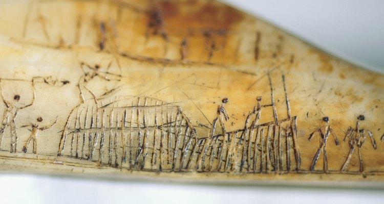 Arte aborigen que representa la construcción de refugios.