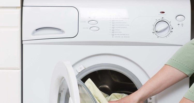 Hands unloading laundry dryer