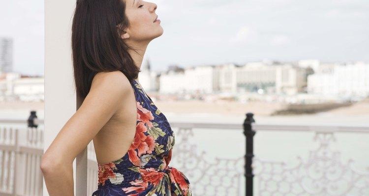 Woman daydreaming at pier, Brighton, england