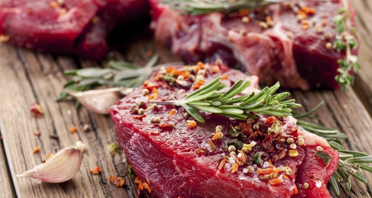Applying a meat tenderizing powder to steak will result in a tender cooked piece of meat.