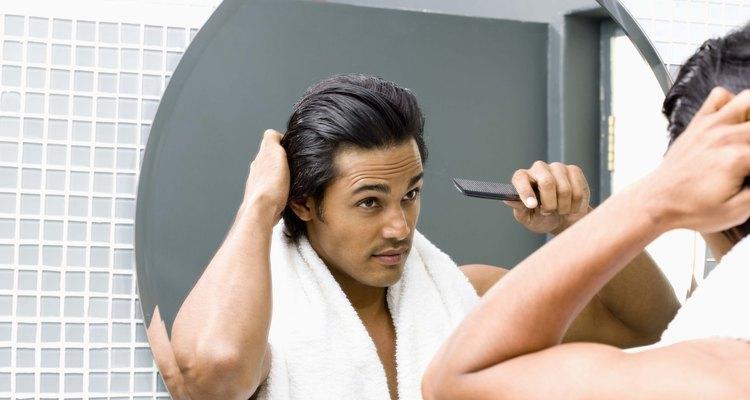 Man combing hair in mirror