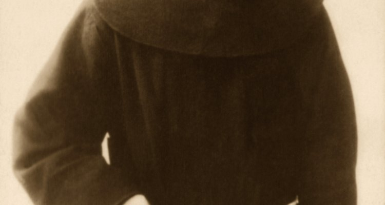 The brown Franciscan habit is belted with a rope girdle.