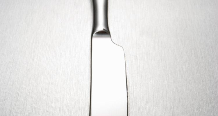 Use uma espátula ou borda de uma colher para remover geleca das roupas