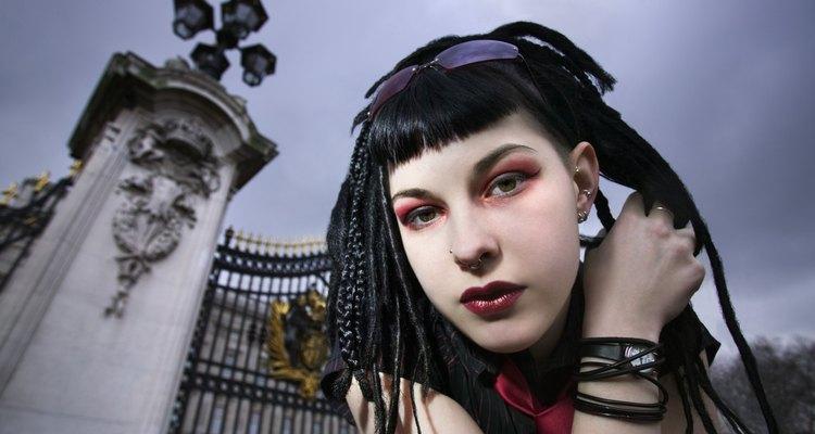 Goths often wear white foundation with heavy black eye make-up.