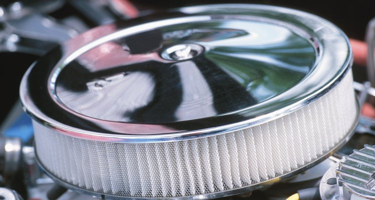 Though cars often have large, open air filters, motorcycles enclose them in a box to concentrate airflow onto their smaller surface area.