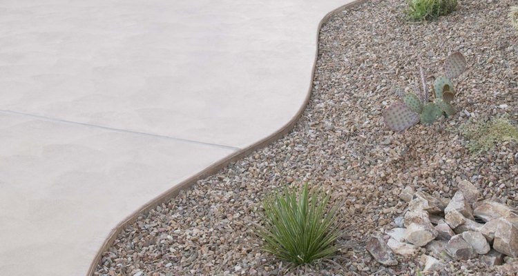 Cut curves in pavers with a cut-off saw.
