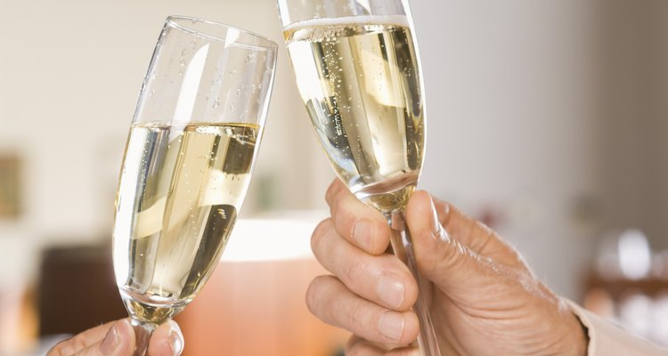 Hands toasting champagne glasses