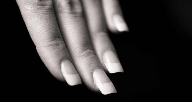 Properly blend the tips when applying artificial nails.