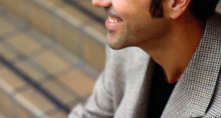 Profile of a Smiling Man Sitting on Stairs