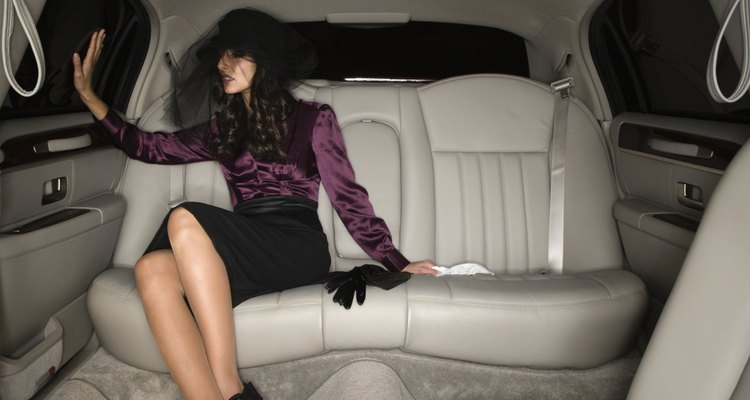 Middle Eastern woman sitting in limousine