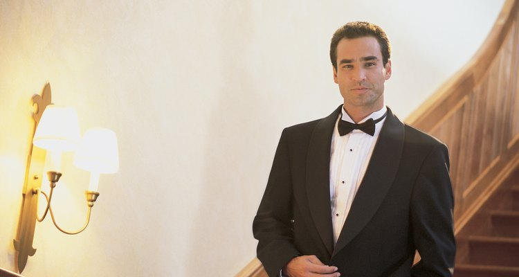Man in tuxedo on stairs