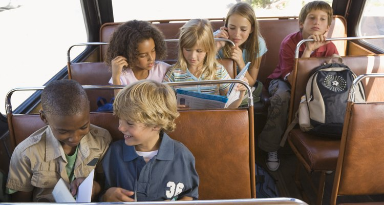 Children can read or study on the bus, but not while walking to school.