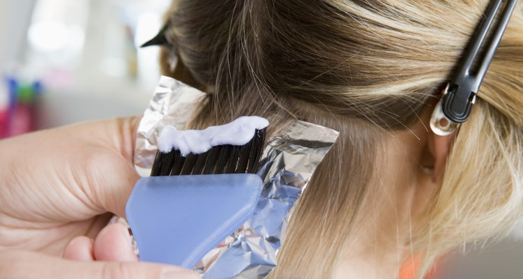 Woman coloring hair