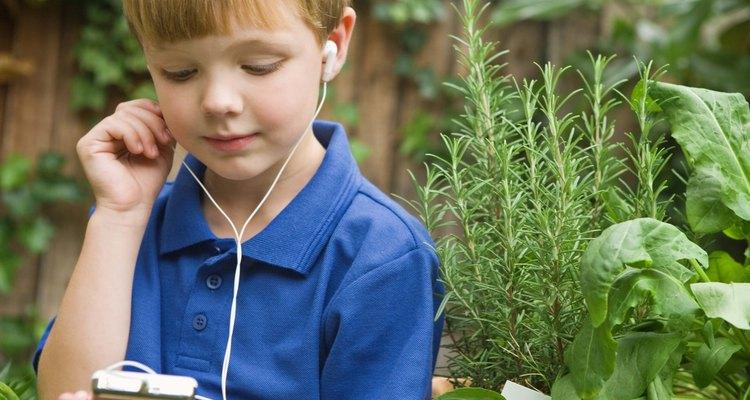 Boy listening to music player in the garden