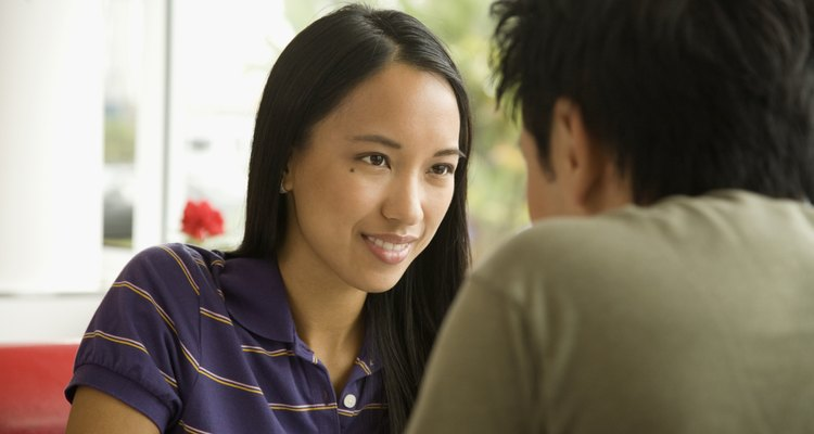 Asian woman smiling at boyfriend