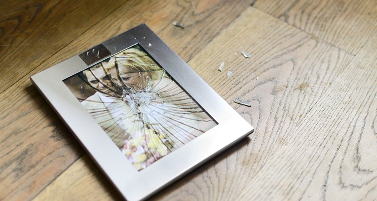 Broken picture frame with married couple