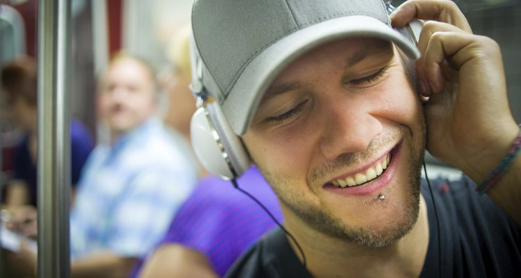 Man with headphones rocking out during subway commute