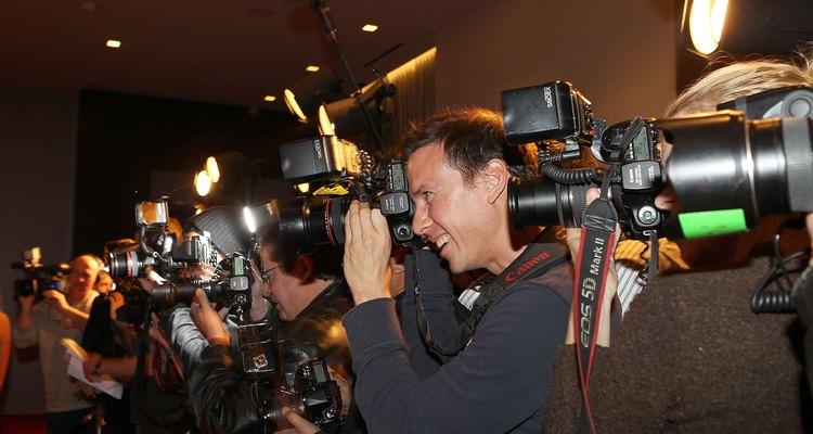 Cinegrafistas enfileirados e gravando