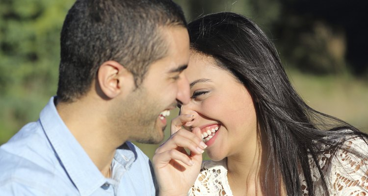 Arab casual couple man and woman flirting and laughing