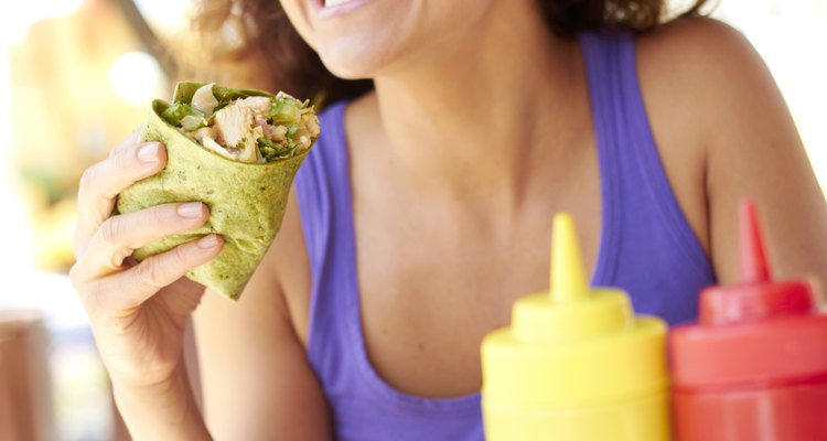 Woman Holding Chicken Wrap
