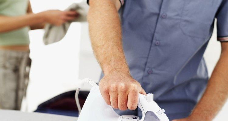 Man ironing a shirt