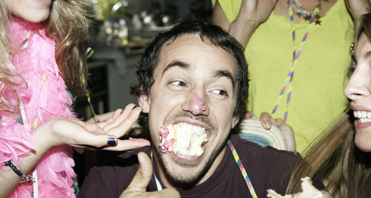 Man with his mouth full of cake
