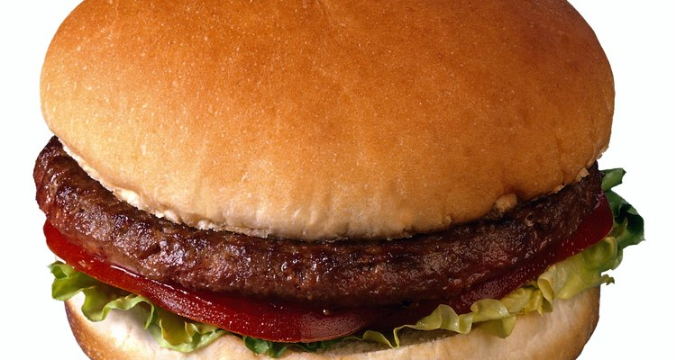 You can help prevent hamburger patties from shrinking during cooking.