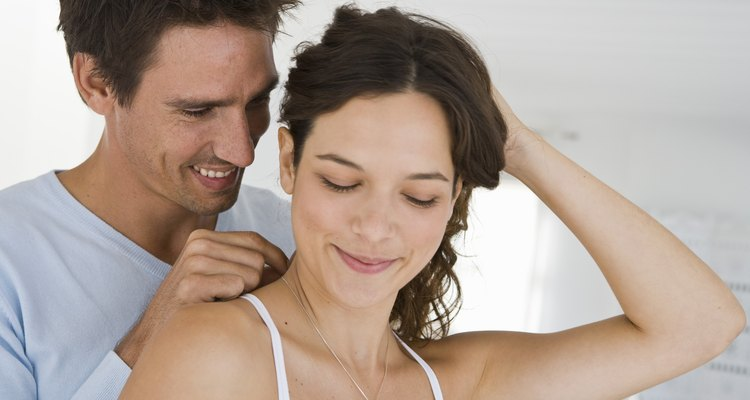 Man giving woman necklace